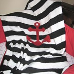 Black and white striped baby afghan with anchor