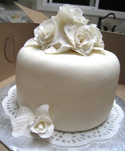 Triple chocolate white rose cake side
