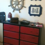 dresser with wall art