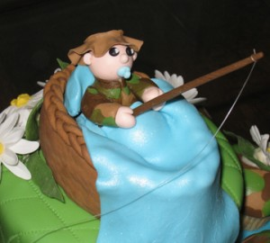 Baby boy fishing on shower cake