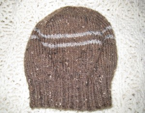 Two colors of tweed with stripes make this a hat for anyone.