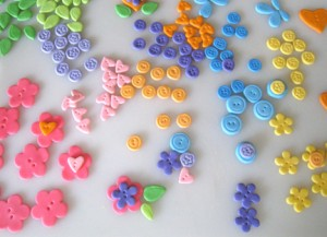 Colorful gum paste buttons and leaves.